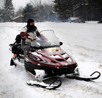 Teen on a snowmobile