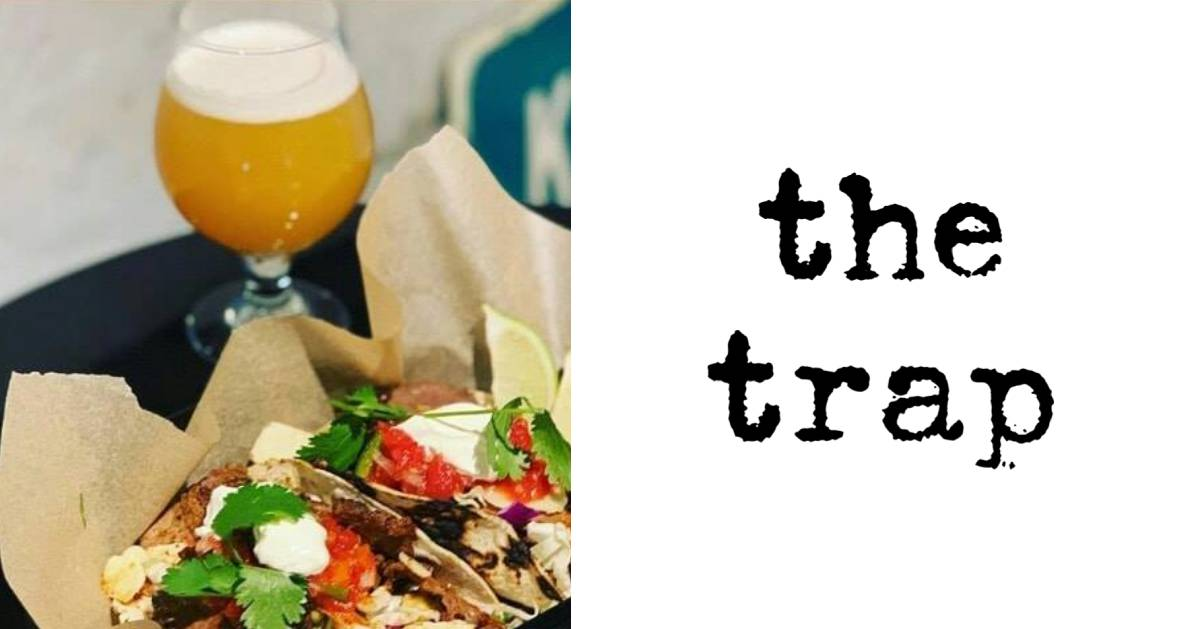 the trap logo and image of beer and food
