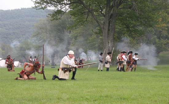 historical reenactment with soldiers and Indians