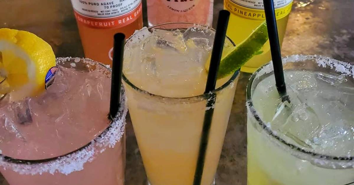 three cold drinks on a bar
