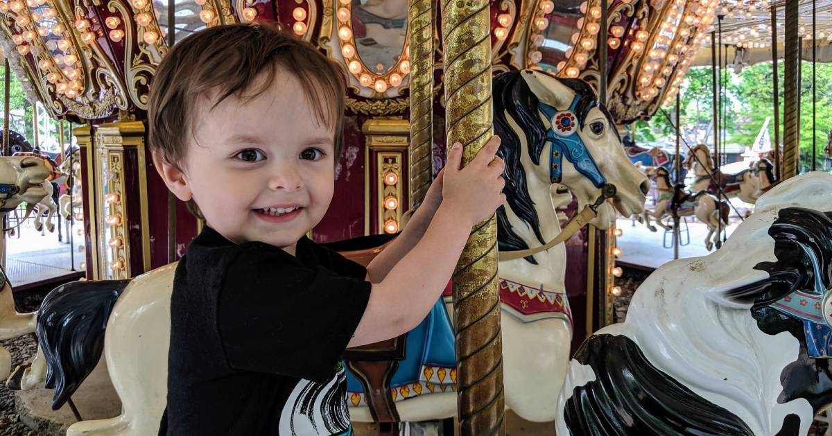 toddler on merry-go-round