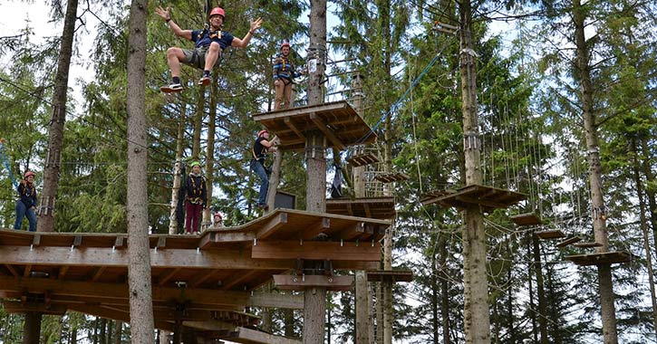 people on an outdoor ropes course