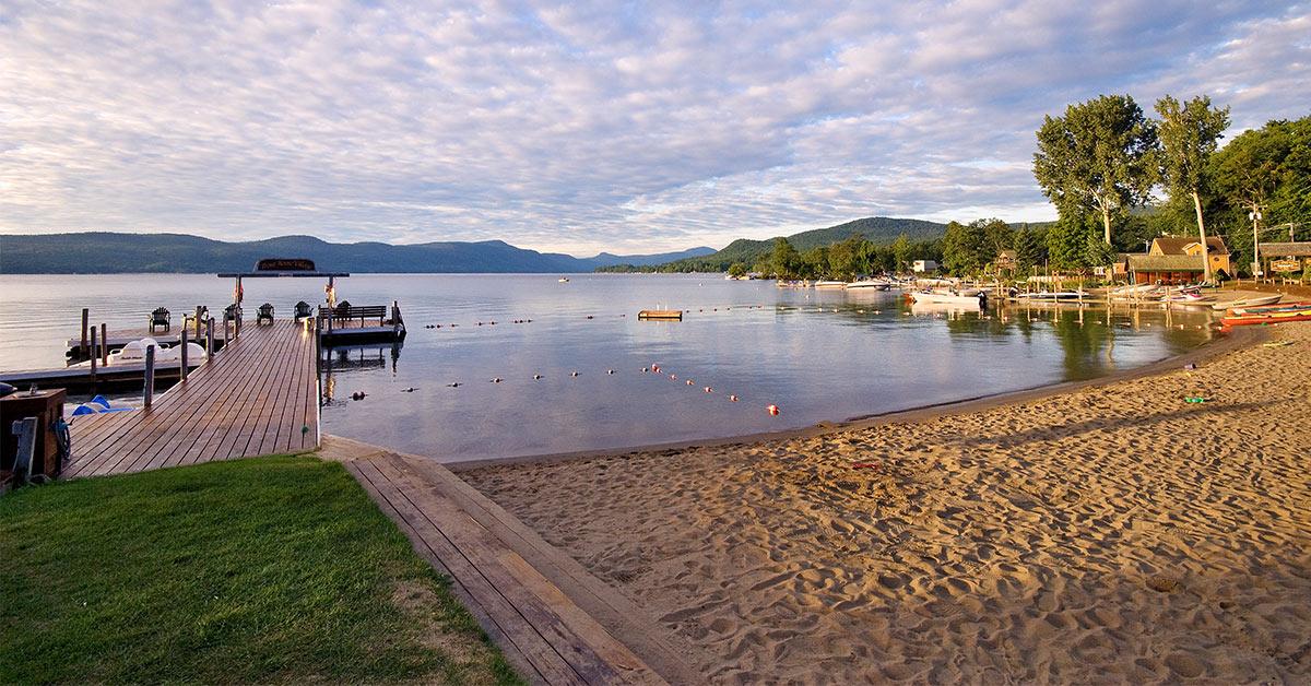 a sandy beach on lake george