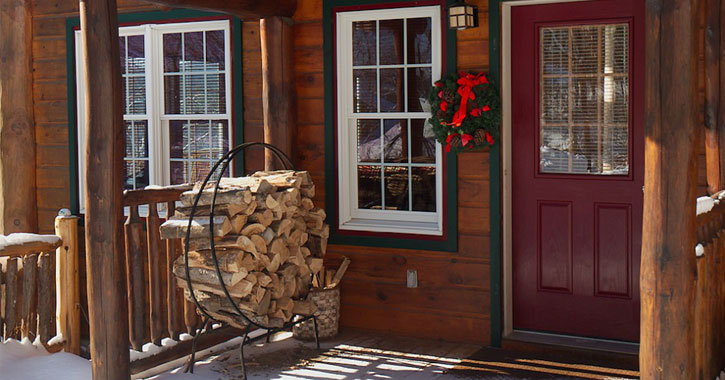 entrance to cabin with stacked logs