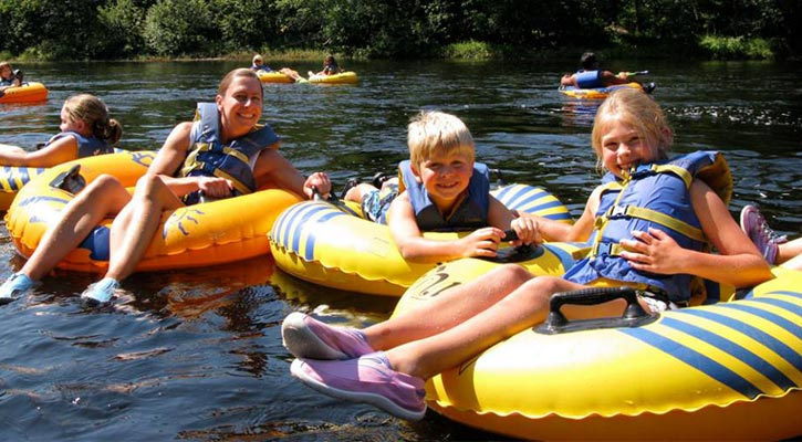 kids on tubes in the river
