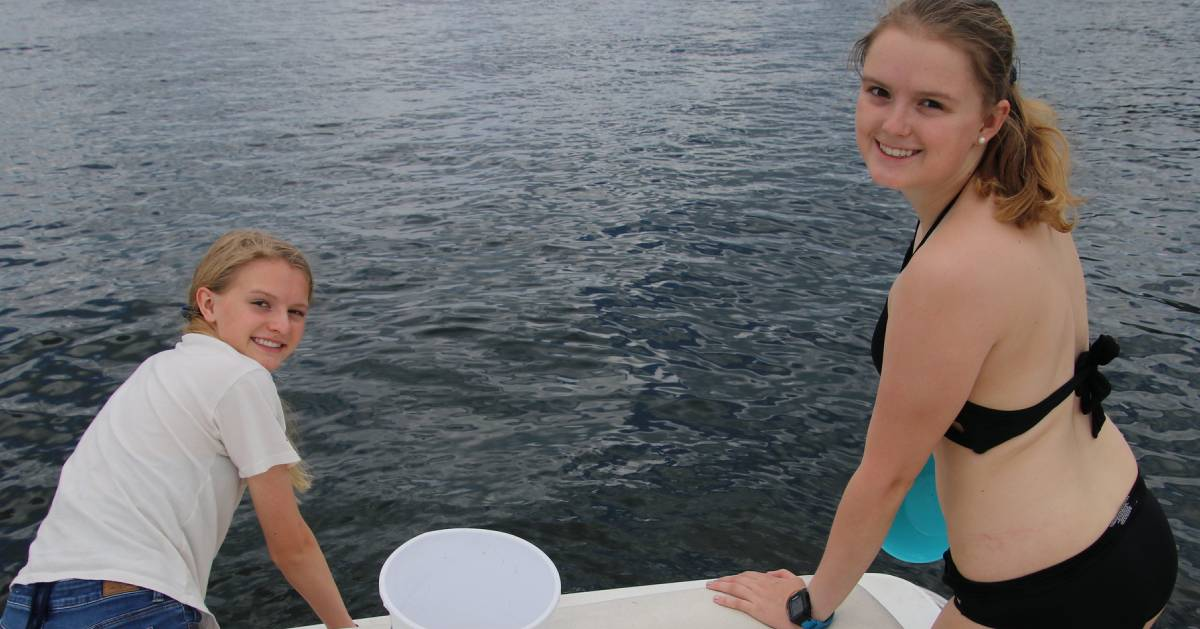 two teen girls on a boat