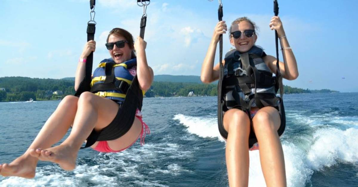 two teens parasailing on lake george