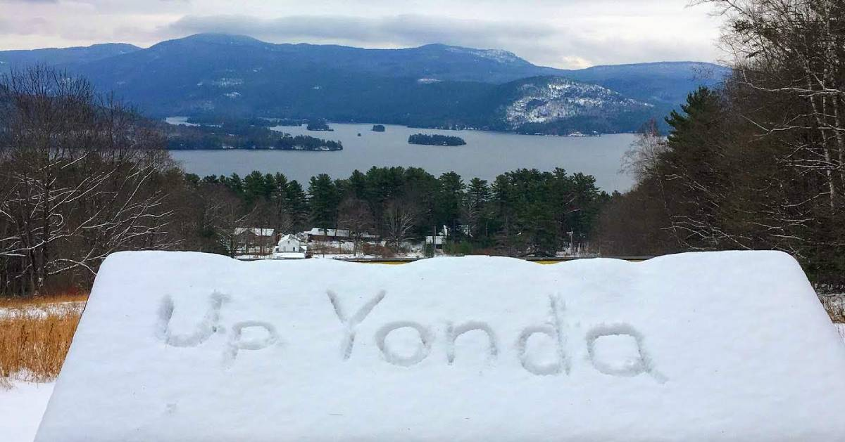 sign covered in snow, Up Yonda written in snow, nice view