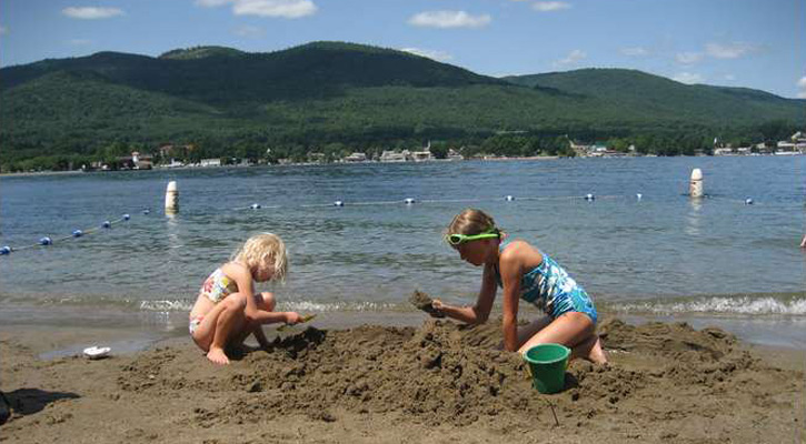 two little girls building sandcastles