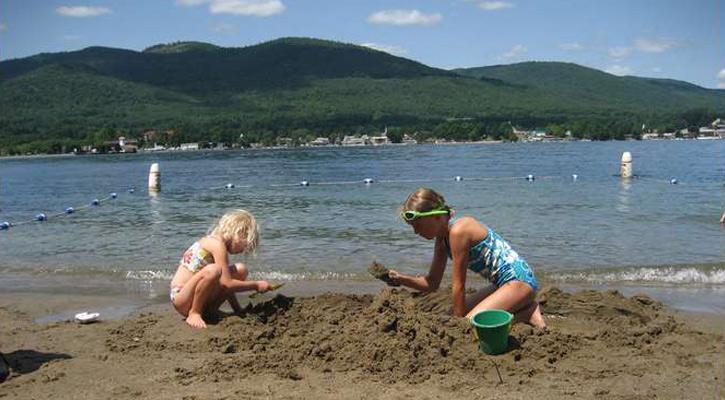 two little girls building sandcastles