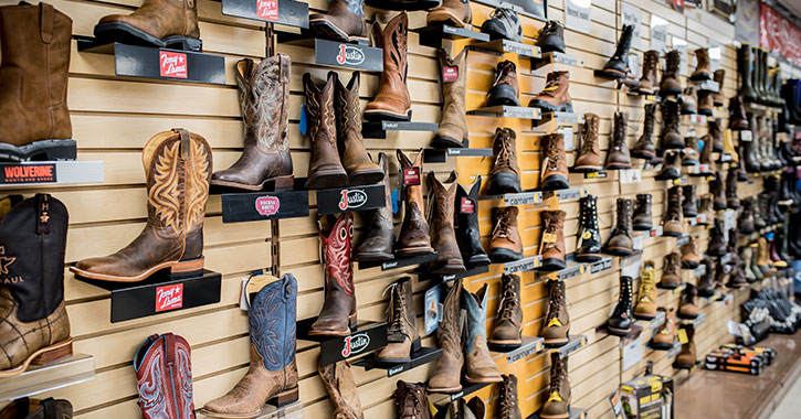 a large display of western and work boots