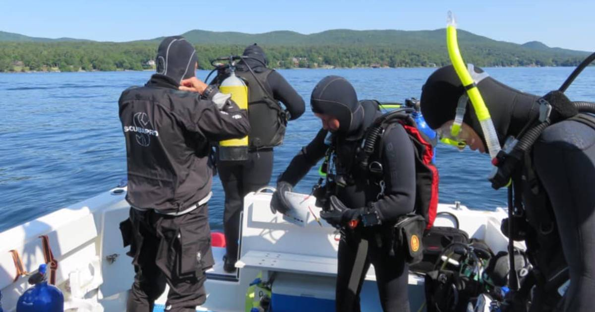 scuba divers on a boat