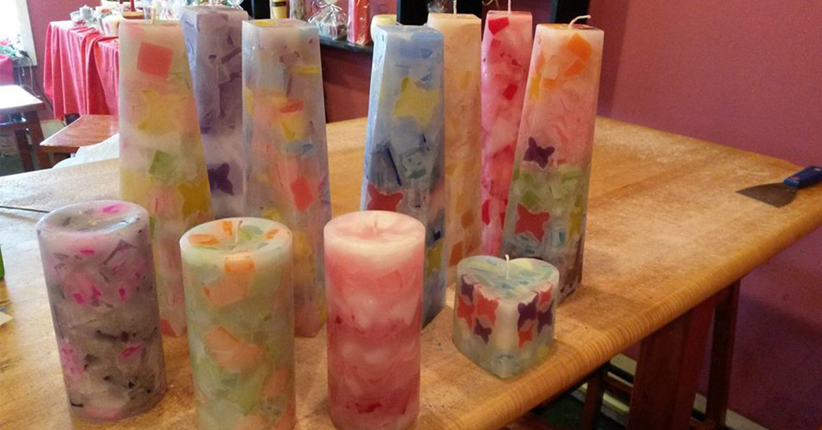 group of homemade candles on a table
