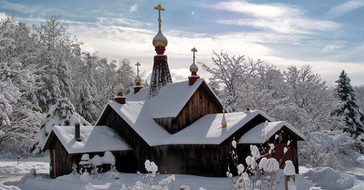 a monastery building covered in snow