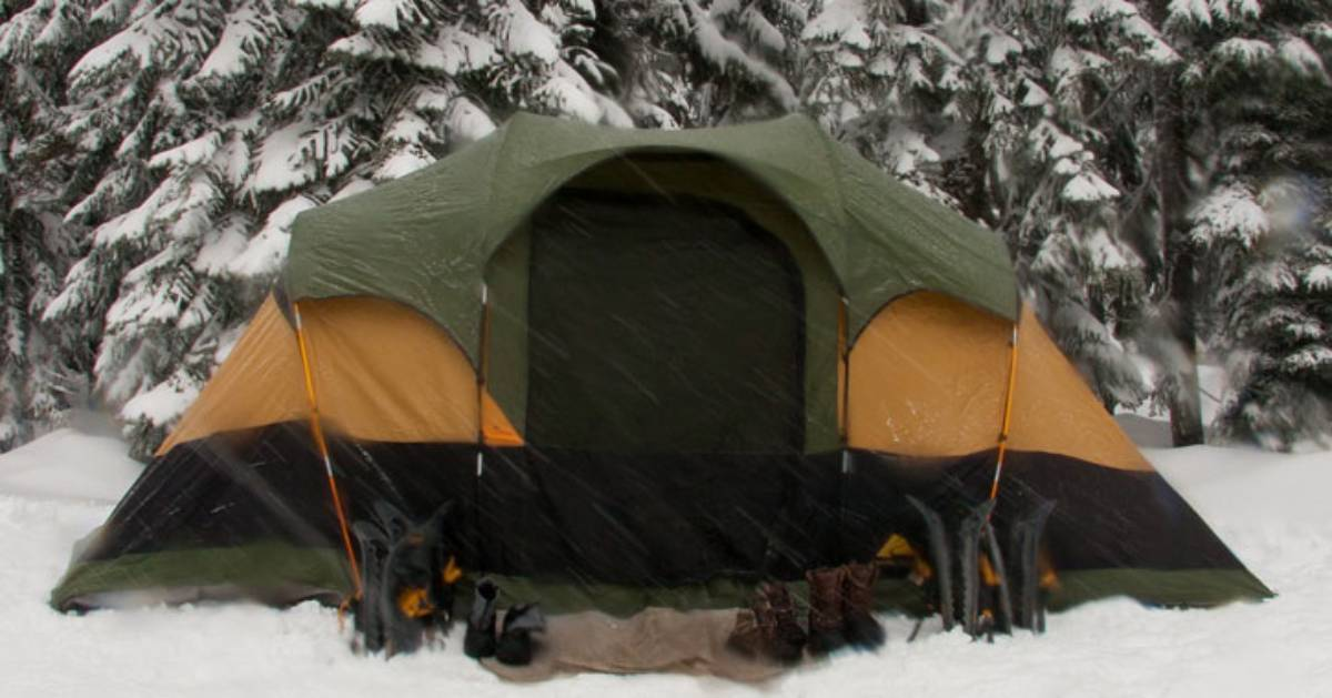 a camping tent set up in the snow