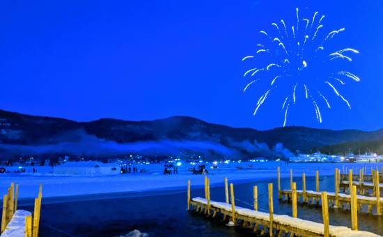 fireworks over lake in winter.