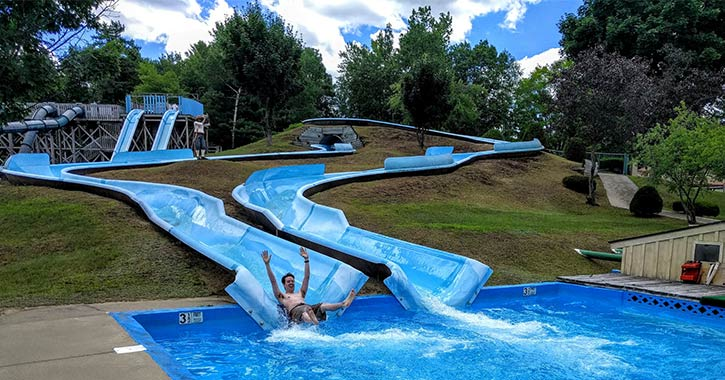 man going down a water slide