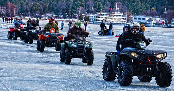 people riding atvs on lake george