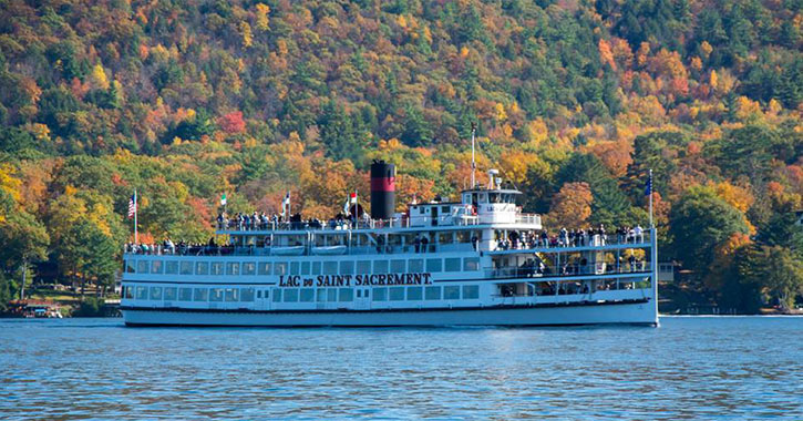 steamboat on lake george with fall foliage in the background