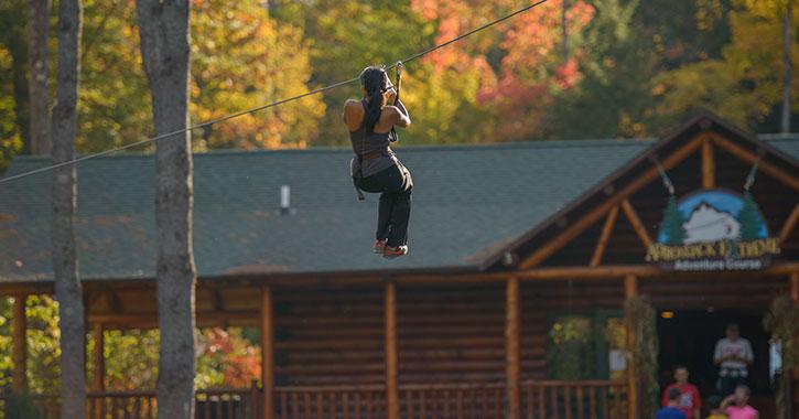 woman riding down a zip line