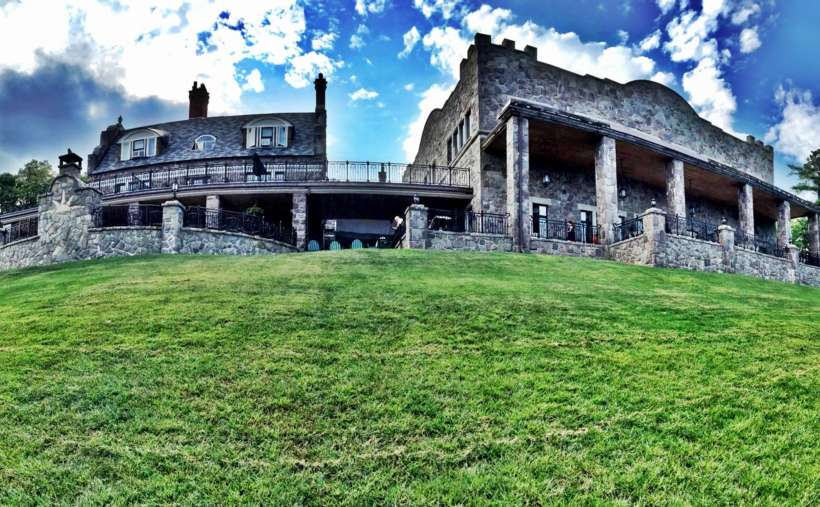 historic stone inn under blue sky