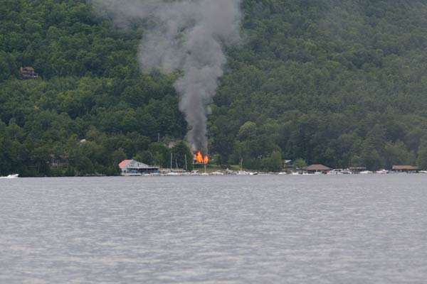 smoke and fire on the opposite shore of lake george