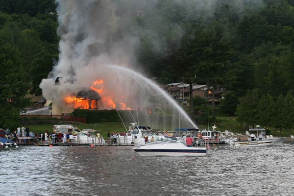 crew putting out fire from the lake