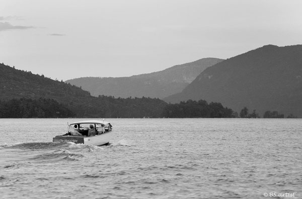 boat heading into the narrows lake george
