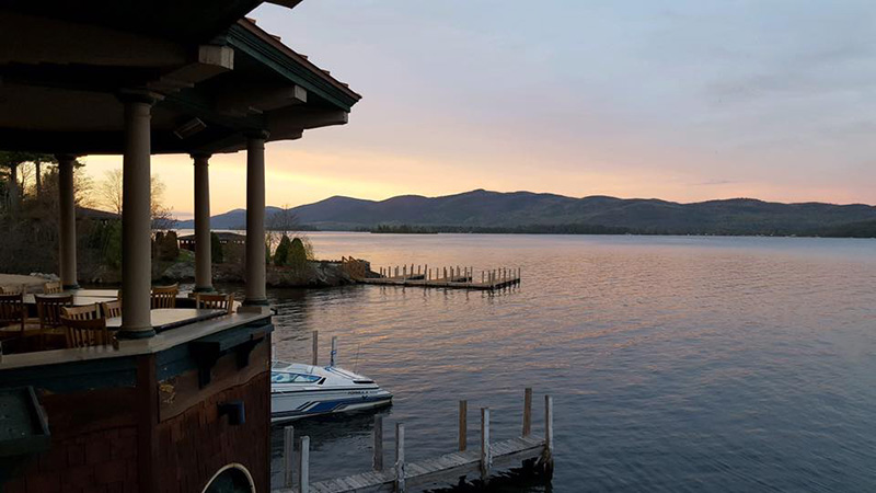 View of sunset and the Adirondack mountains from The Boathouse Restaurant on Lake George
