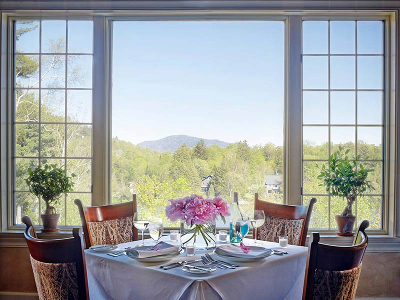 Picturesque view of the Adirondacks from a table in front of a window at The View at Mirror Lake