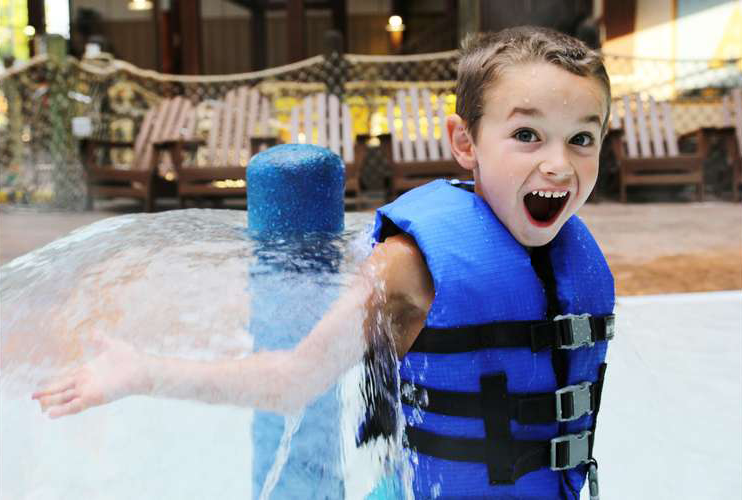 boy having fun at water park