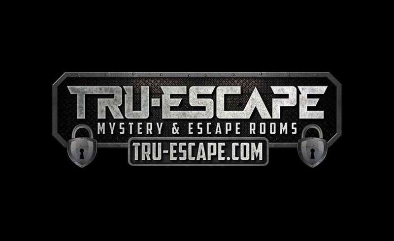 tru escape business logo on black background