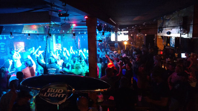 crowd enjoying live music at king neptune's pub