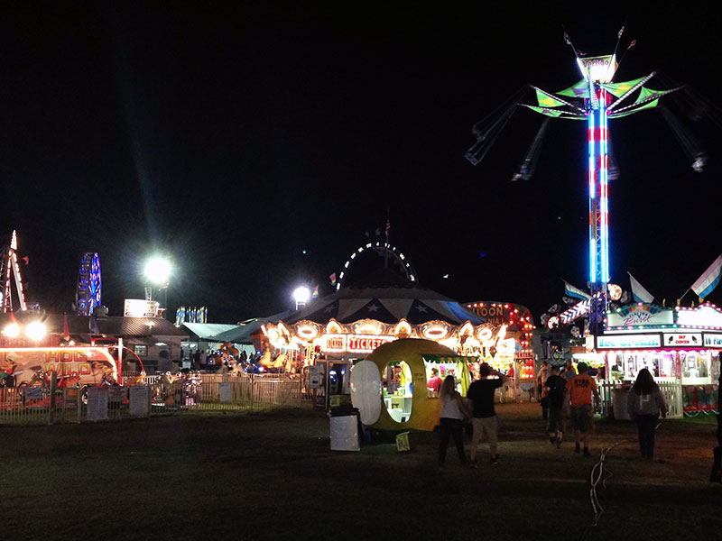 Midway rides and food stands at the Essex County Fair