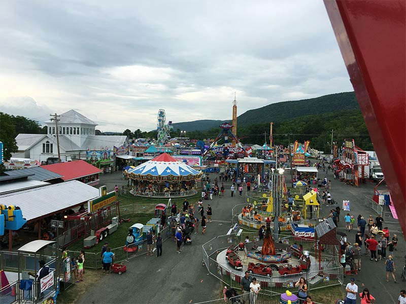 Midway filled with rides and stalls at the New York State Fair