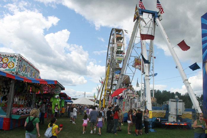 Midway filled with rides and games at the Washington County Fair