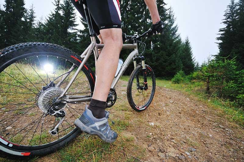 Close up of a man downhill mountain biking