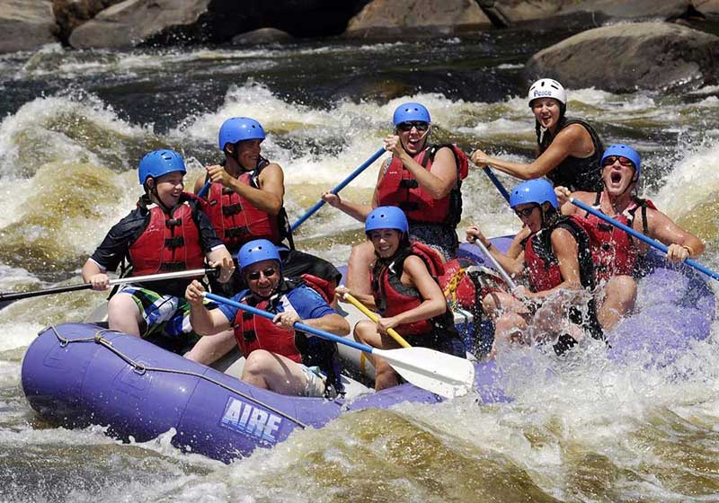 Whitewater rafters navigating rapids on the Hudson River near North Creek NY