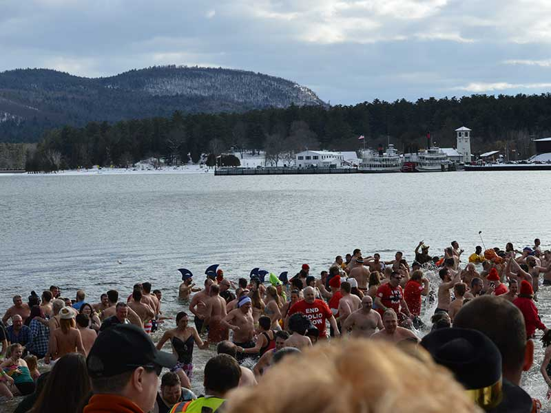 People braving the cold waters of Lake George during the annual News Years Day Polar Plunge