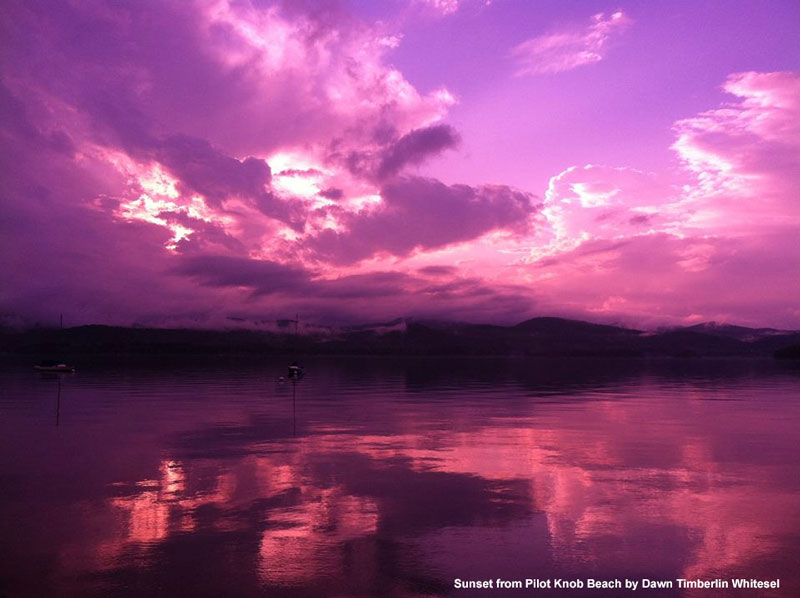 pink sky reflected in lake george at sunset