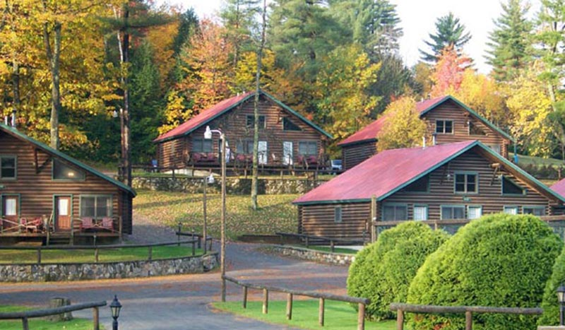 cabins in the woods surrounded by fall foliage