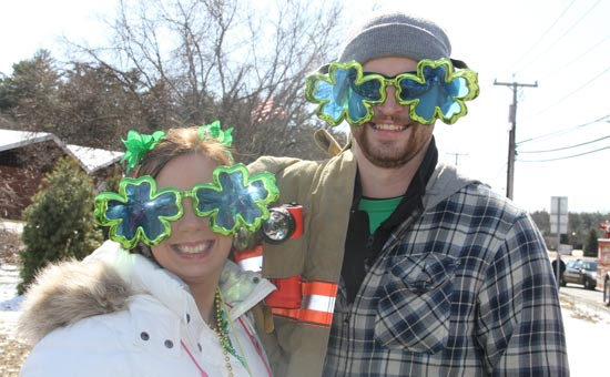 couple wearing four-leaf clover glasses