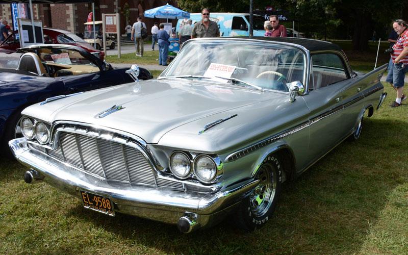 a silver classic car at a car show