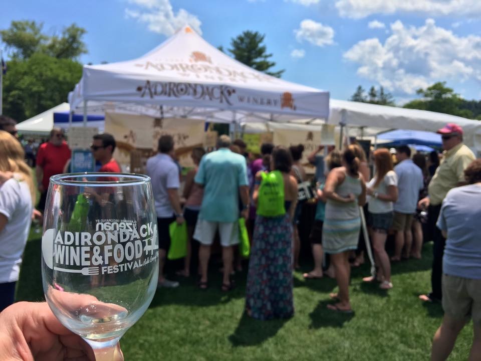 wine glass and crowd on sunny day