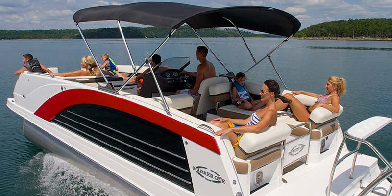 group of people in bathing suits on a boat in Lake George