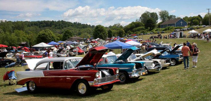 lineup of cars at a car show