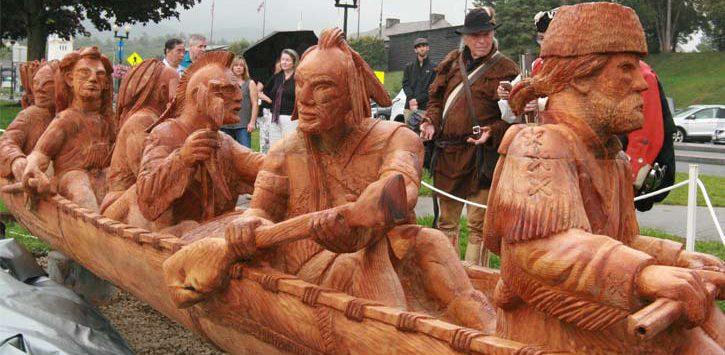 sculpture of Indians in canoe