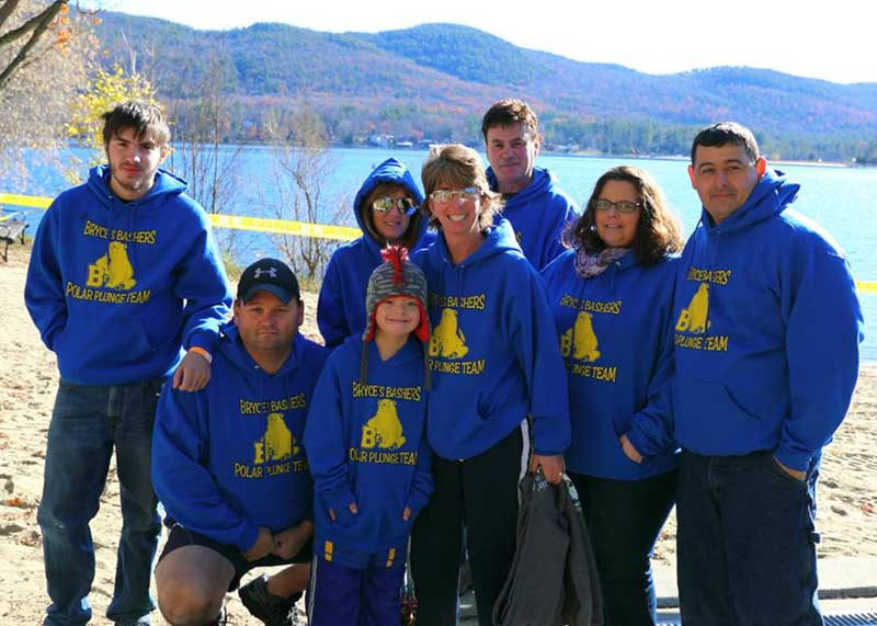 "Kim & Bryce Reynolds plus friends pose for a photo in their ""Bryce's Bashers"" hoodies at the Lake George Polar Plunge"