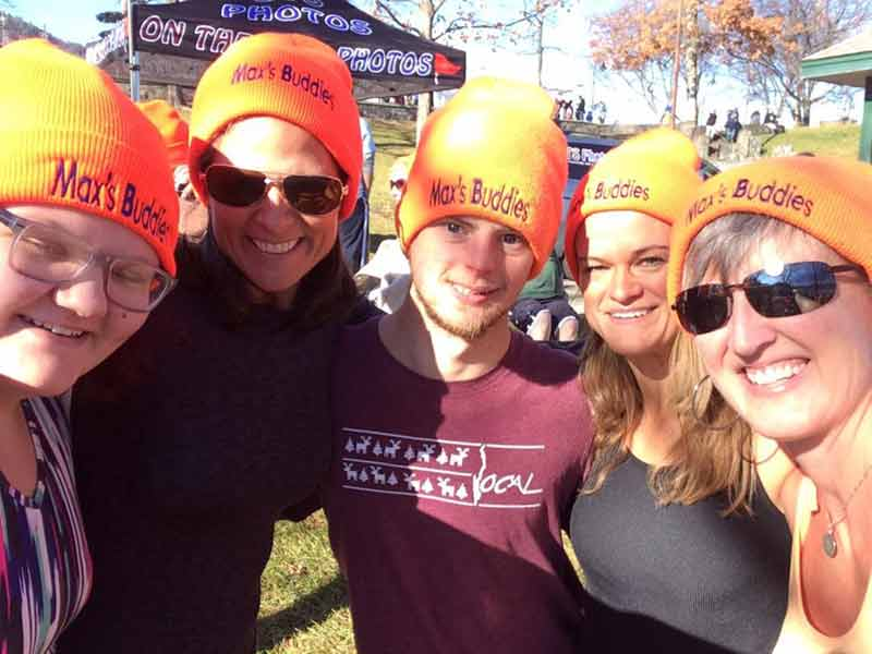 "Lisa and Max Jackoski, with friends, wearing orange ""Max's Buddies"" hats at the Polar Plunge"