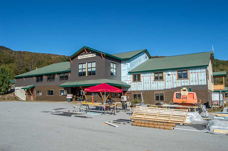 Northwoods Lodge at Gore Mountain being resided during 2017 offseason construction